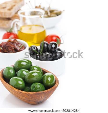 assorted antipasti - olives, pickles, olive oil and ciabatta, isolated on white - stock photo