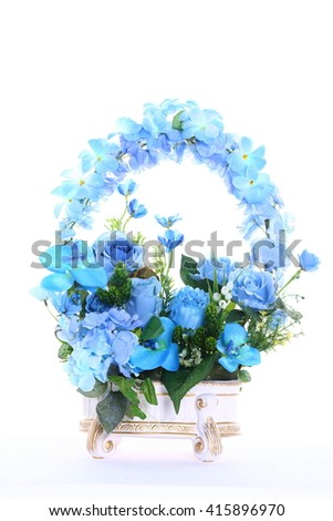 Assorted Artificial Flower Bouquet in multiple Color of Blue in White Gold Vase and many kind of flowers in Studio Lighting on White Background - stock photo