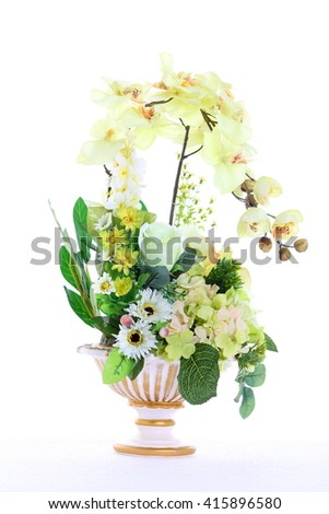 Assorted Artificial Flower Bouquet in multiple Color of Yellow in White Gold Vase  and many kind of flowers in Studio Lighting on White Background - stock photo