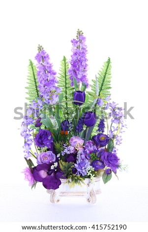 Assorted Artificial Flower Bouquet in White Gold Vase in multiple Color of Purple and many kind of flowers in Studio Lighting on White Background