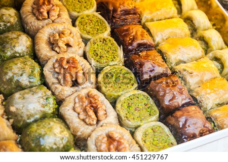 Assorted baklava, it is sweet pastry made of layers of filo with chopped nuts and sweetened and held together with honey. Traditional for former Ottoman Empire and Middle East, selective focus