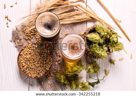 Assorted Beer on a wooden table. Ready for Tasting. - stock photo