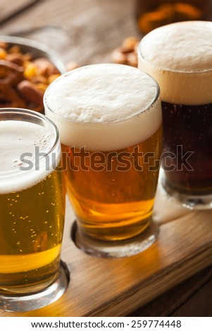 Assorted Beers in a Flight Ready for Tasting - stock photo