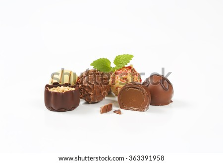 assorted belgian chocolate pralines on white background - stock photo