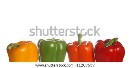 Assorted bell peppers against white background. - stock photo