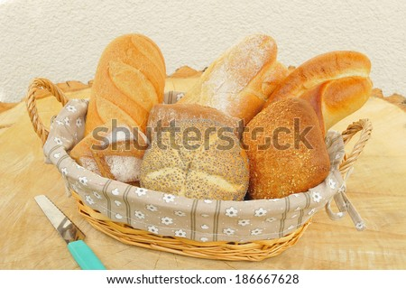 Assorted bread rolls in a bread basket. - stock photo