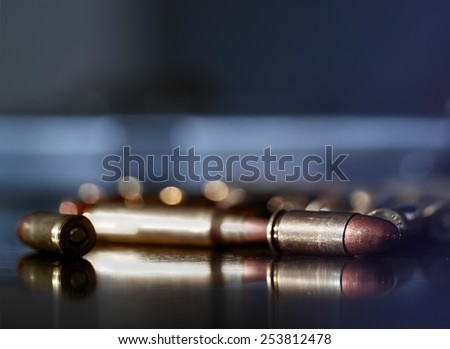 Assorted bullets on a table, indoor shot with shallow depth of field - stock photo