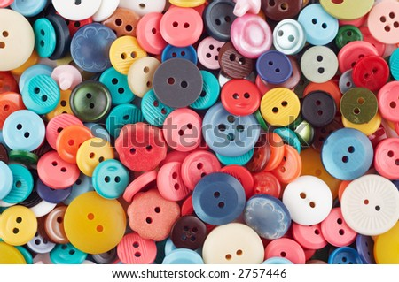 Assorted buttons as colorful background. Sewing accessories.