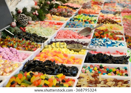 Assorted candies on outdoor Christmas Market - stock photo