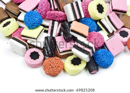 Assorted candy sweets and liquorice on white background with space for text