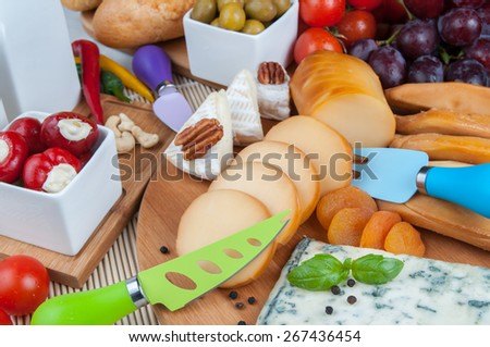 Assorted cheese on table - stock photo