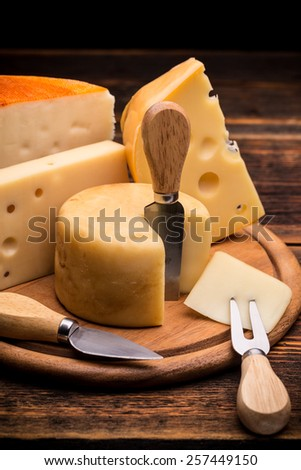 Assorted cheese on wooden board