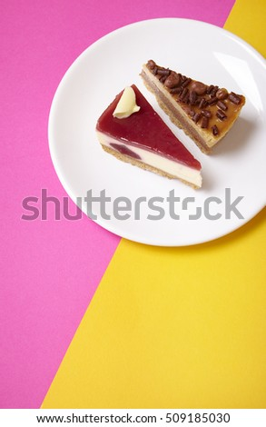 Assorted cheesecake desserts on a brightly colored background forming a page header