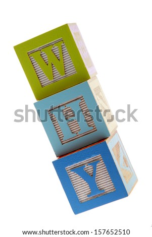 Assorted children's toy letter building blocks against a white background/Children's alphabet blocks spelling the words why - stock photo