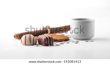 Assorted chocolate and cookies on white background