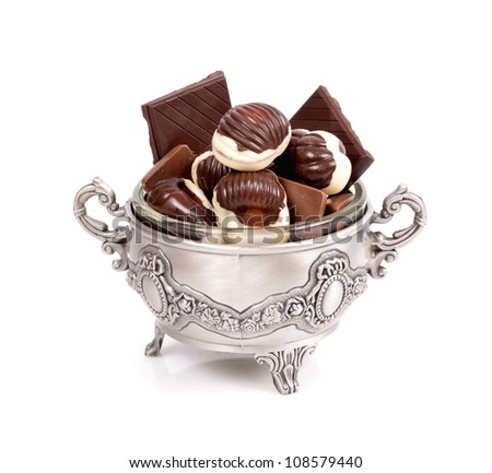 Assorted chocolate candies ,chocolate, in a metal container close-up  on white background - stock photo