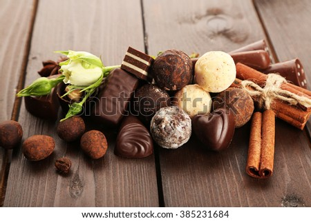 Assorted chocolate candies on a wooden background, close up - stock photo