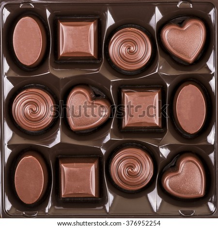 assorted chocolate candy box, top view - stock photo