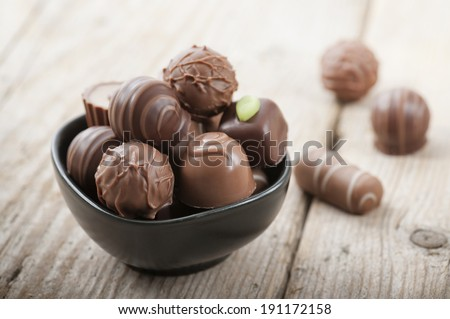 assorted chocolates confectionery in a black bowl - stock photo