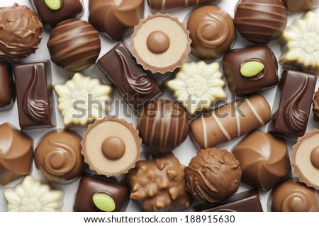 assorted chocolates confectionery on white background - stock photo