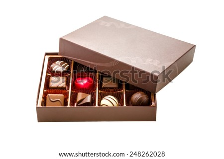 Assorted chocolates in brown box, with lid half off - stock photo