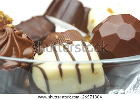 Assorted chocolates, isolated on white - stock photo