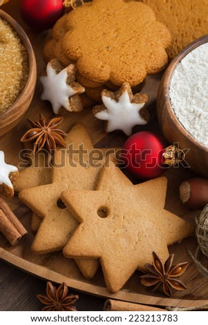 Assorted Christmas cookies, decorations and spices, top view, vertical
