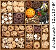 Assorted Christmas cookies in wooden box with baking items - stock photo