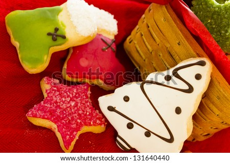 Assorted christmas cookies on red background. - stock photo