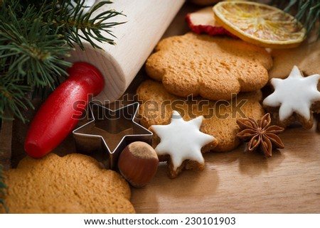 Assorted Christmas cookies, spices on wooden board, selective focus, close-up