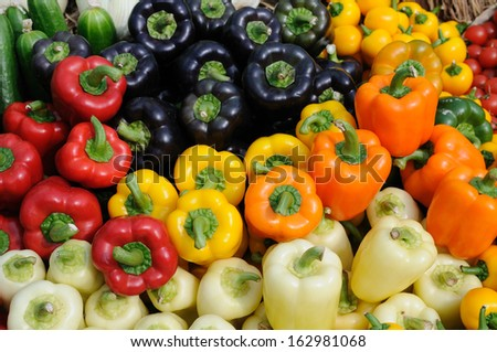 Assorted color of bell peppers background - stock photo