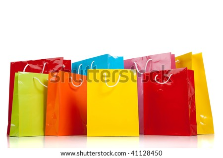 Assorted colored shopping bags including yellow, orange, red, pink, blue and green on a white background
