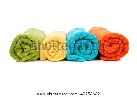 Assorted colored towels including green, yellow, blue and orange on a white background
