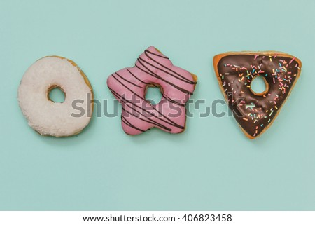 Assorted Colorful Donuts set on Pastel Background. Flat lay. Top view. Minimal concept. - stock photo