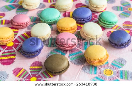 Assorted colorful french macarons confect on abstract flower easter background Delicious biscuit merinque from France on table for bakery business website blog magazine book cover food design recipe - stock photo