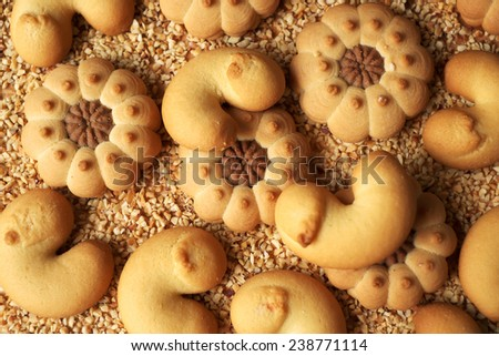 Assorted cookies with cocoa and jam on a board - stock photo