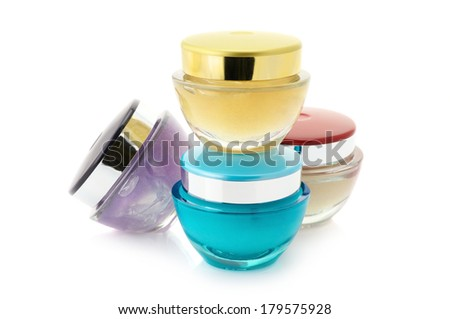 Assorted cosmetic creams isolated on white background.