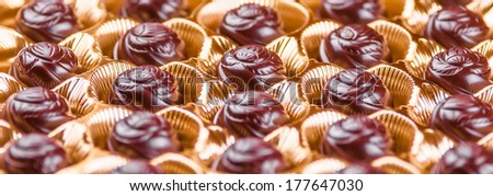 Assorted delicious chocolate pralines background