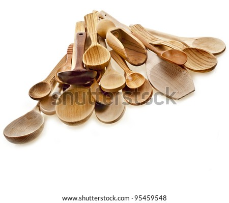 Assorted different kitchen wooden utensils cutlery on a white background - stock photo