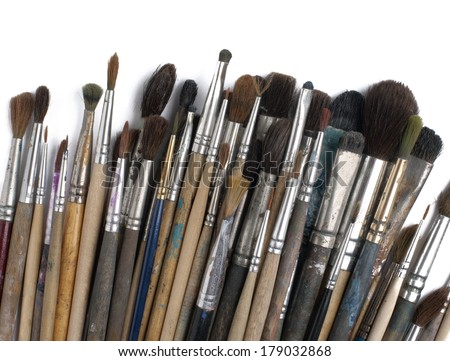 Assorted dirty old painting brushes. Isolated on white - stock photo