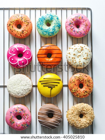 Assorted donuts with different fillings on white background - stock photo