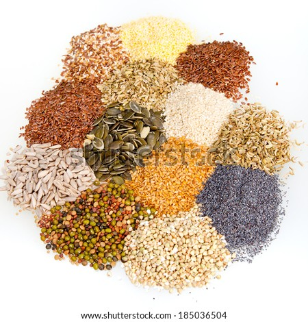 Assorted dried culinary seeds used as cooking ingredients or spices arranged in piles, high angle view