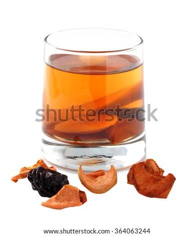 Assorted dried fruit compote in a glass on a white background. Isolated photo.