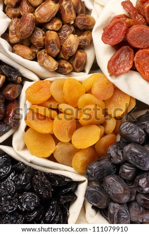 Assorted dried fruits in bags. - stock photo