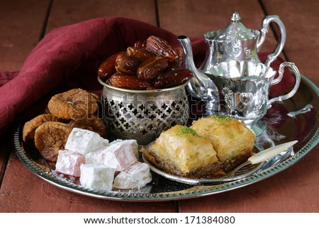 Assorted eastern sweets - baklava, dates, turkish delight - stock photo