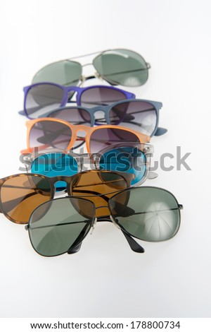 Assorted Fashionable Sunglasses on Light Background