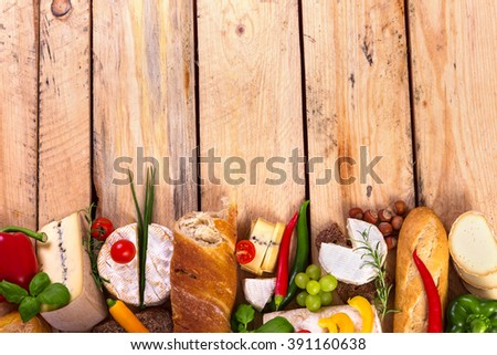 assorted food ingredients - cheese, bread, vegetables and copy space ready to be filled with some text - stock photo