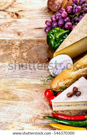 assorted food ingredients - cheese, bread, vegetables and copy space ready to be filled with some text