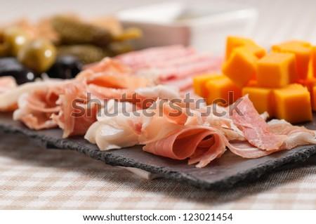 assorted fresh cold cut platter Italian appetizer - stock photo