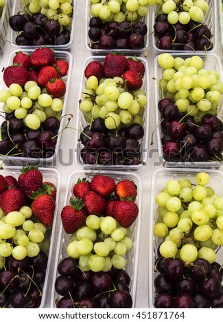 Assorted fresh fruit on display at a farmers market - stock photo